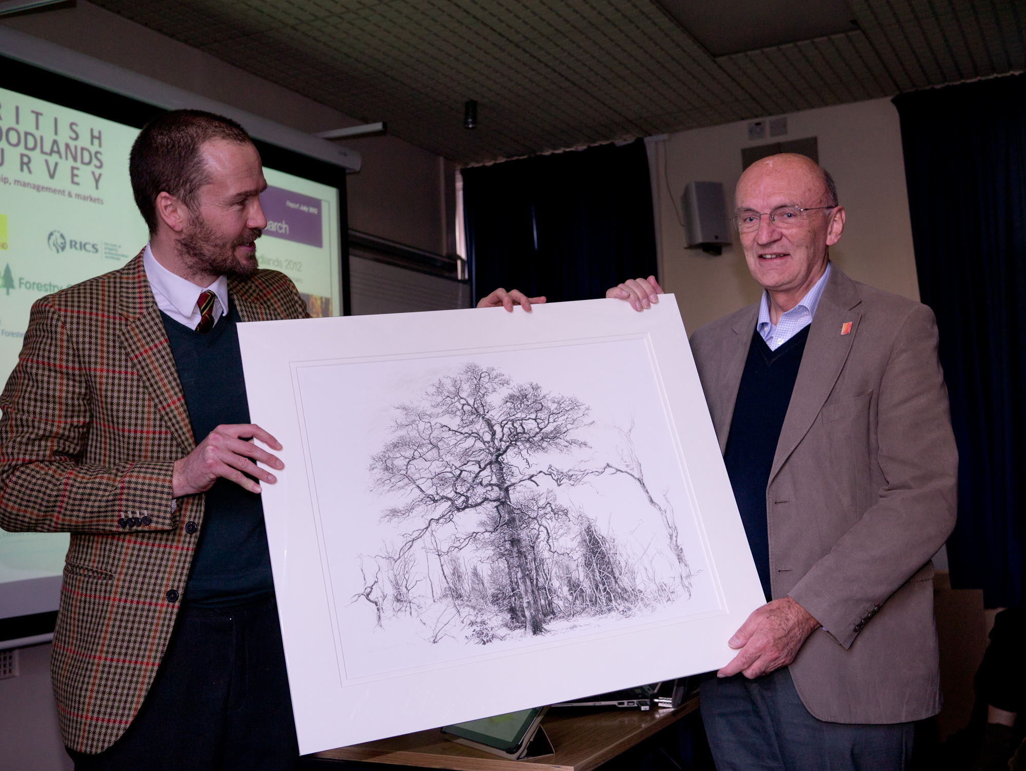Alistair Yeomans presents a gift of appreciation to Dr Derek Nicholls of Cambridge University