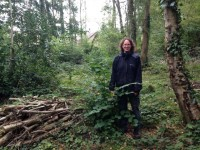 Ranger Marie-Anne Phillips standing next to a recently coppiced hazel in Tinkers Copse
